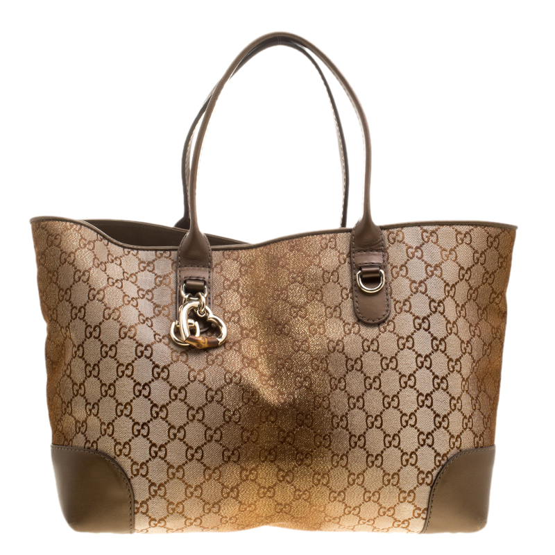 07daaa460bab ... Gucci Beige Bronze GG Canvas and Leather Medium Charms Embellished Heart  Bit Tote. nextprev. prevnext