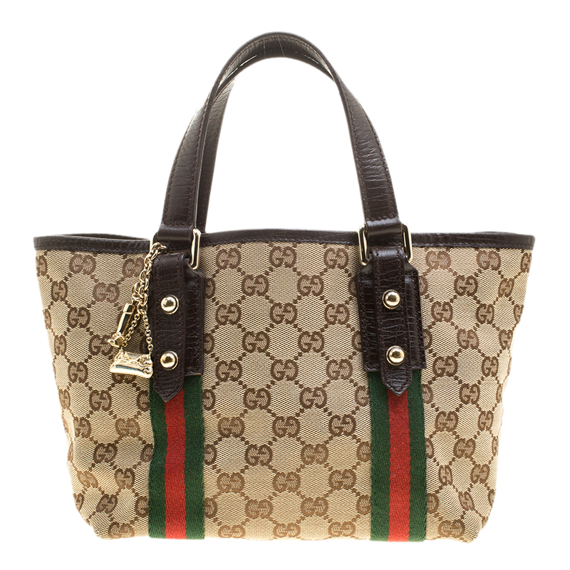 d59347f71da7 ... Gucci Beige/Brown GG Canvas Mini Jolicoeur Web Tote. nextprev. prevnext