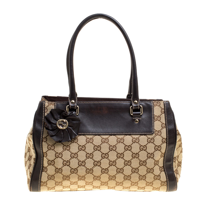 624640ab4ab9 ... Gucci Beige Brown GG Canvas and Leather Small Trophy Tote. nextprev.  prevnext