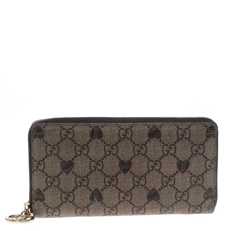 33f5572b7e420f ... Gucci Beige GG Supreme Canvas Zip Around Wallet. nextprev. prevnext