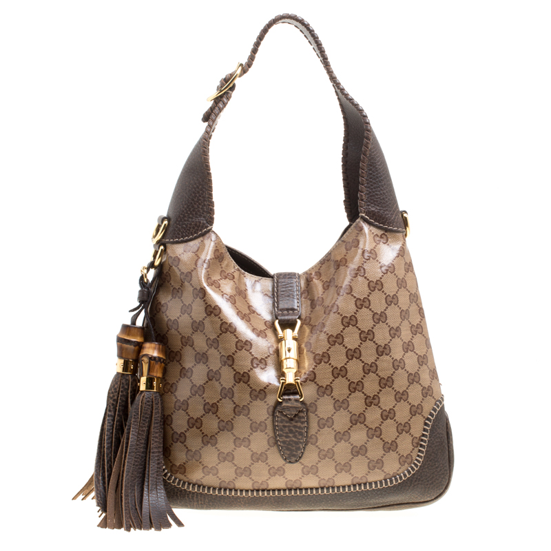 fb40d27cc2ce ... Gucci Biege/Brown GG Crystal Canvas and Leather Medium Jackie Hobo.  nextprev. prevnext