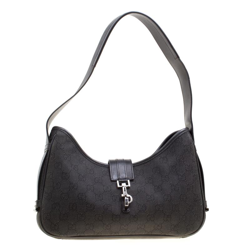 c3f9a99284f ... Gucci Dark Grey Black GG Canvas and Leather Shoulder Bag. nextprev.  prevnext