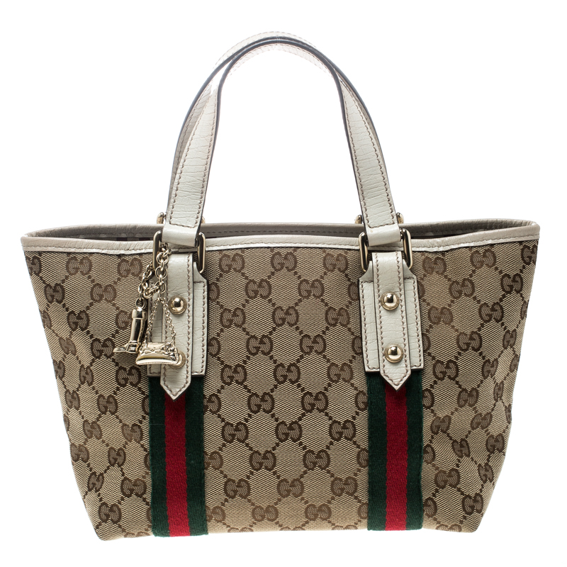 0c7150d8f6db ... Gucci Beige/White GG Canvas and Leather Mini Jolicoeur Web Tote.  nextprev. prevnext