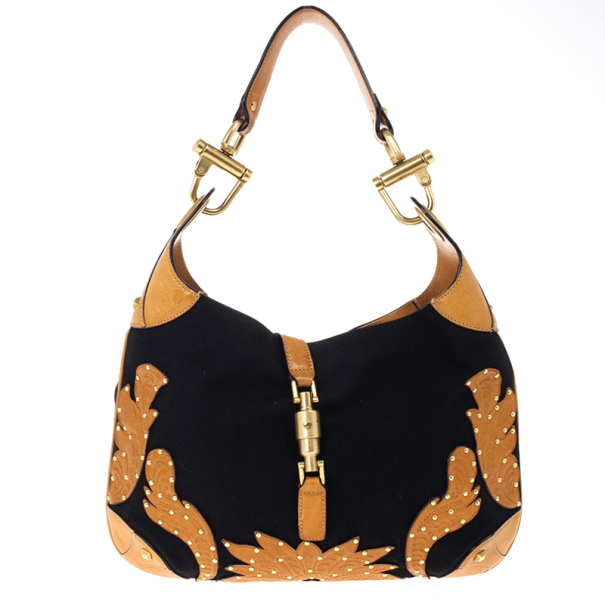 b7ee311edb7a ... Gucci Canvas And Brown Leather 'New Jackie' Hobo. nextprev. prevnext