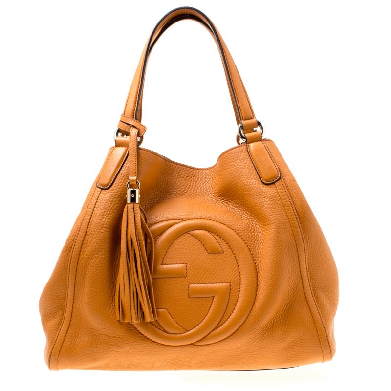 b09c91df604 ... Gucci Orange Pebbled Leather Medium Soho Tote. nextprev. prevnext