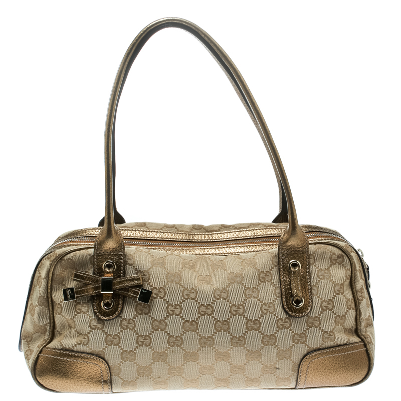 5f7fa02c578 ... Gucci Beige Gold GG Canvas and Leather Princy Boston Bag. nextprev.  prevnext