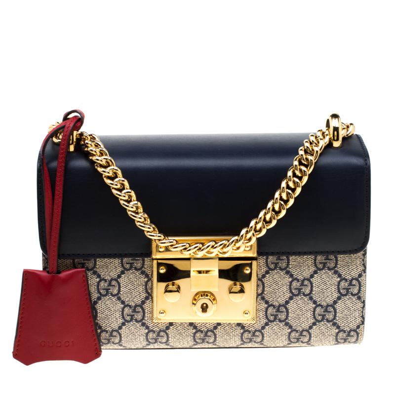 f8963efda99 ... Gucci Navy Blue Leather and GG Supreme Monogram Canvas Small Padlock  Shoulder Bag. nextprev. prevnext