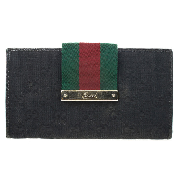 4d26a904268 Buy Gucci Black Continental Wallet With Engraved Gucci Script Logo ...