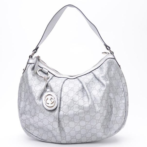5e817fbecae0 ... Gucci Silver Guccussima Leather Sukey Medium Hobo. nextprev. prevnext