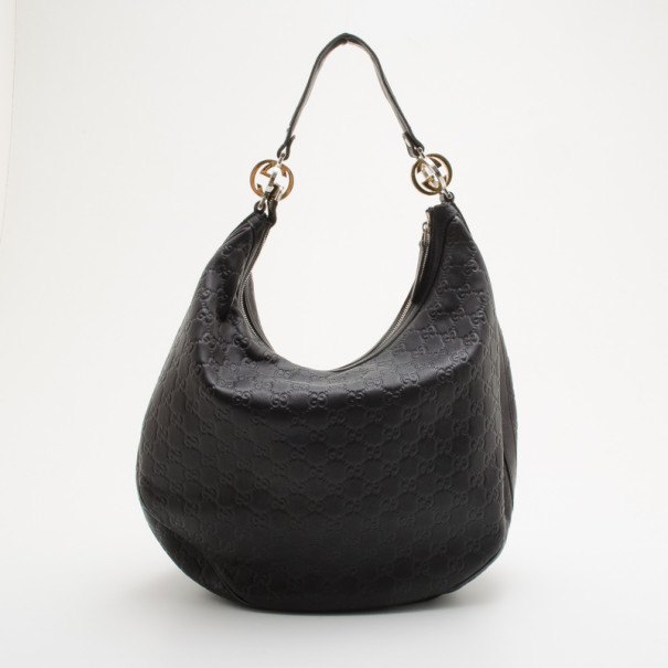 033a3b8c431a ... Gucci Black Guccissima 'GG Twins' Medium Hobo. nextprev. prevnext
