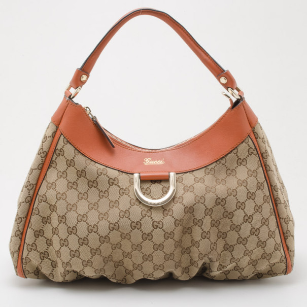 41b5f7997 Buy Gucci Beige GG Canvas Gold D Ring Hobo Bag 36009 at best price | TLC