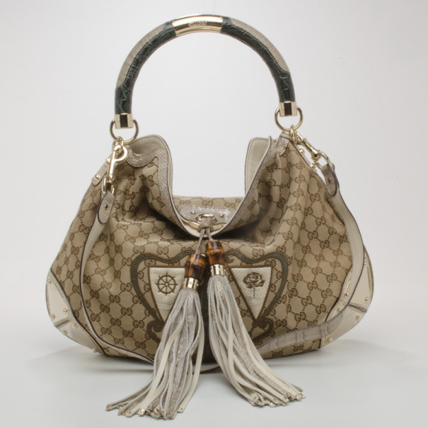 46fa0a786493b9 ... Gucci Large Limited Edition Crest Patchwork Indy. nextprev. prevnext