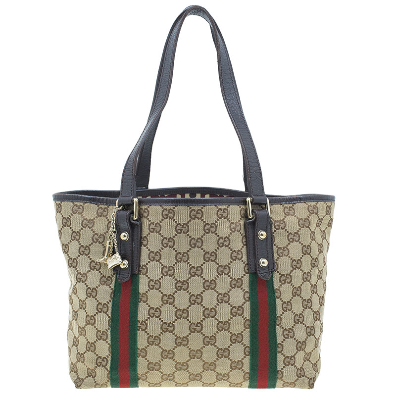 4de75690be3 ... Gucci Beige Canvas Leather GG Jolicoeur Medium Tote Bag. nextprev.  prevnext