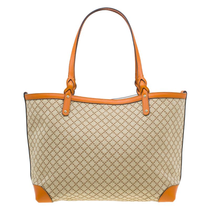 79442a8a2 ... Gucci Orange Diamante Canvas Medium Craft Tote Bag. nextprev. prevnext