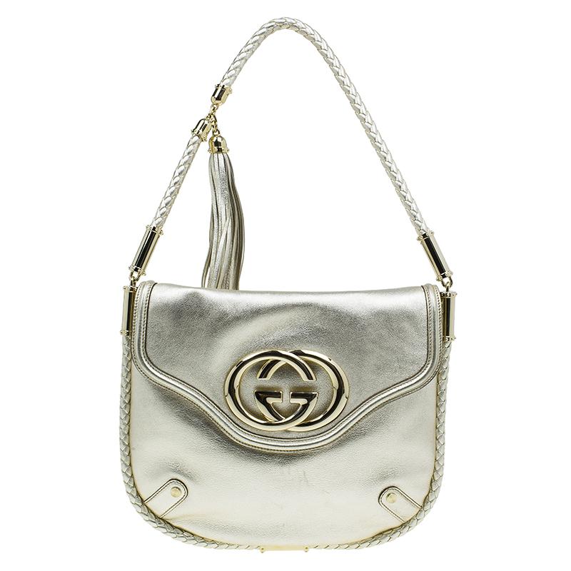 ceff0c2d0c0 ... Gucci Metallic Silver Leather Medium Britt Tassel Hobo. nextprev.  prevnext