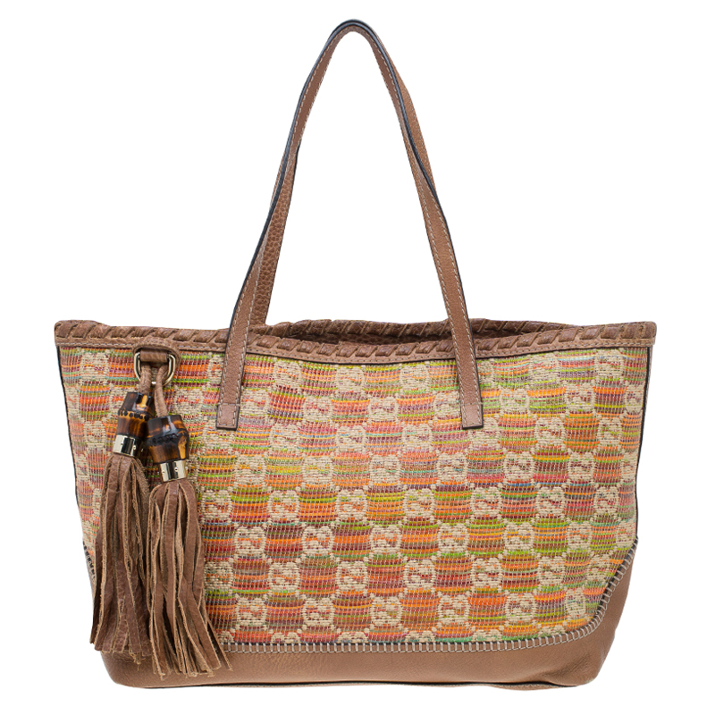 0adeb2d9819e29 ... Gucci Multicolor Raffia and Leather Sunset Tassel Tote. nextprev.  prevnext
