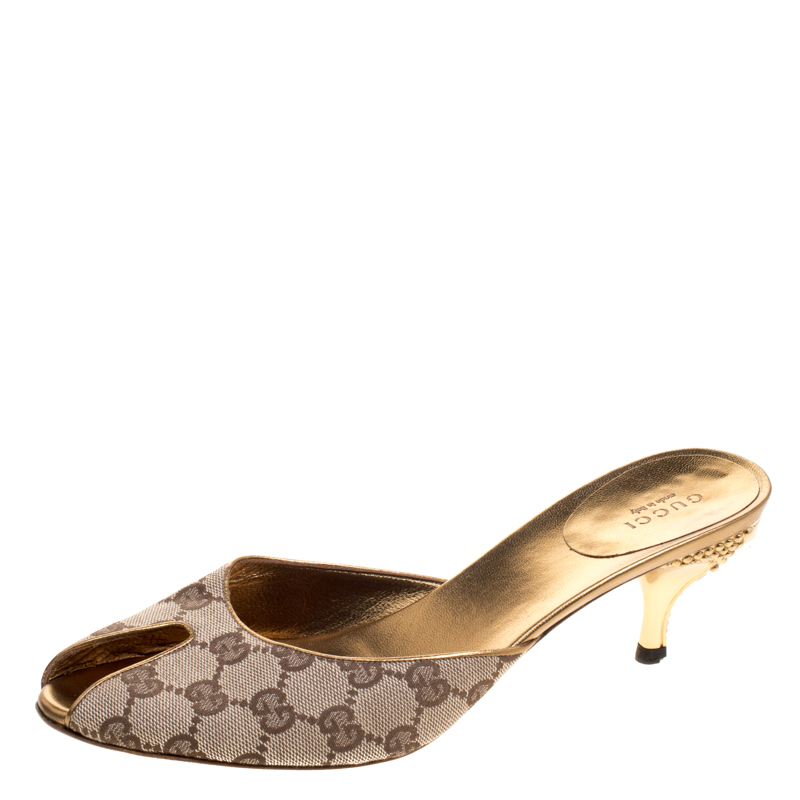 52736558be6 ... Gucci Beige GG Canvas Studded Heel Peep Toe Mules Size 39. nextprev.  prevnext