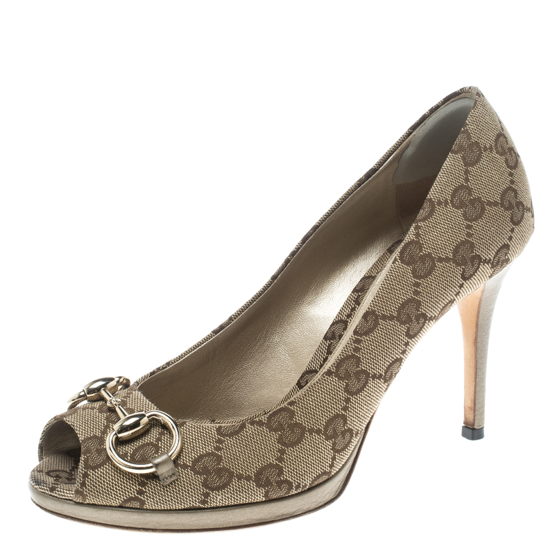 235e85c9af5 ... Gucci Beige GG Canvas and Leather New Hollywood Horsebit Peep Toe Pumps  Size 37. nextprev. prevnext