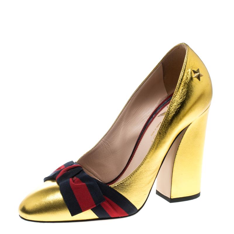 98f3d2232ff2 ... Gucci Metallic Gold Leather Web Bow Detail Pumps Size 37.5. nextprev.  prevnext