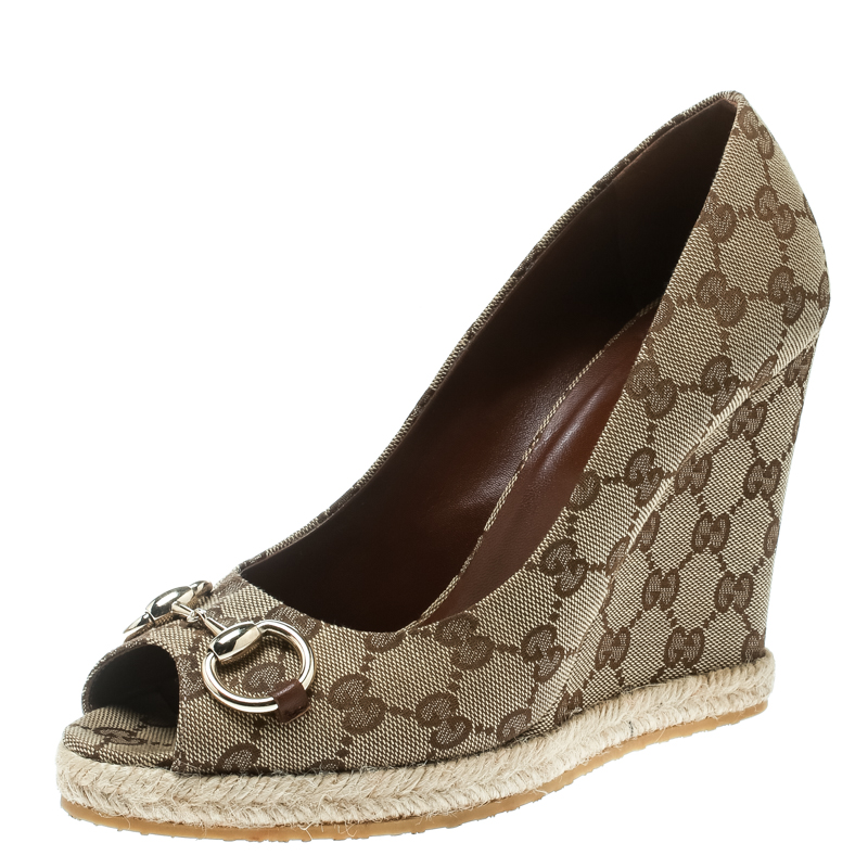 414fef852 ... Gucci Beige GG Canvas Charlotte Horsebit Peep Toe Wedge Pumps Size 39.  nextprev. prevnext