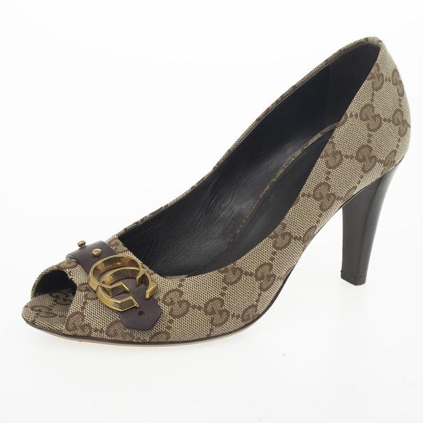 6497e7de86b ... Gucci Guccisima Canvas  GG  Peep Toe Pumps Size 38. nextprev. prevnext