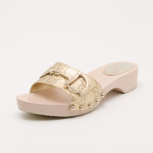 ef43d2bd0 Buy Gucci Metallic Guccissima 'Icon Bit' Wooden Clog Slides Size ...