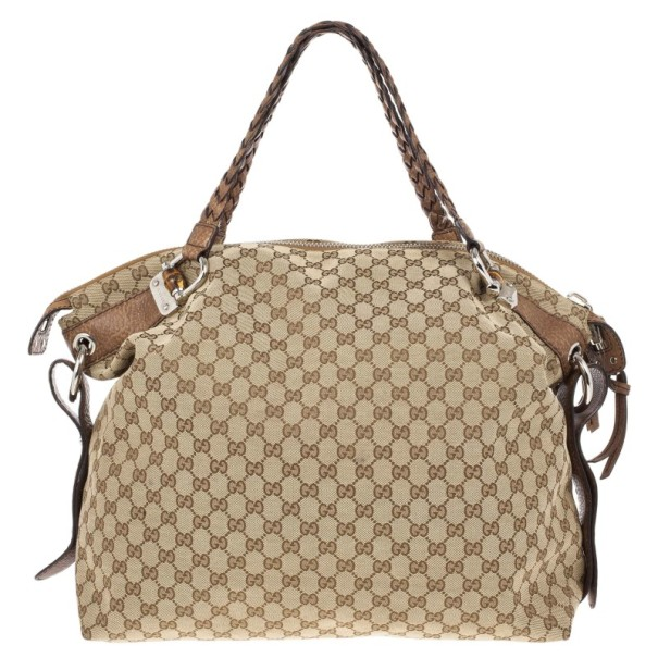 18ecc5b6c45c ... Gucci Beige GG Canvas Large 'Bamboo Bar' Travel Tote. nextprev. prevnext