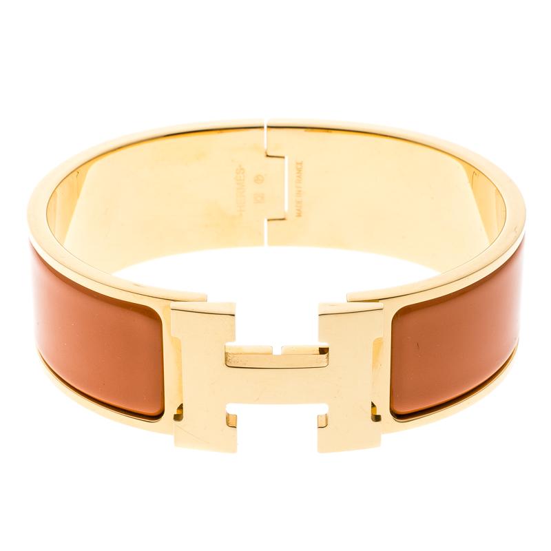 ... Hermes Clic Clac H Gold Plated Orange Enamel Bracelet. nextprev.  prevnext cdf11a580ec
