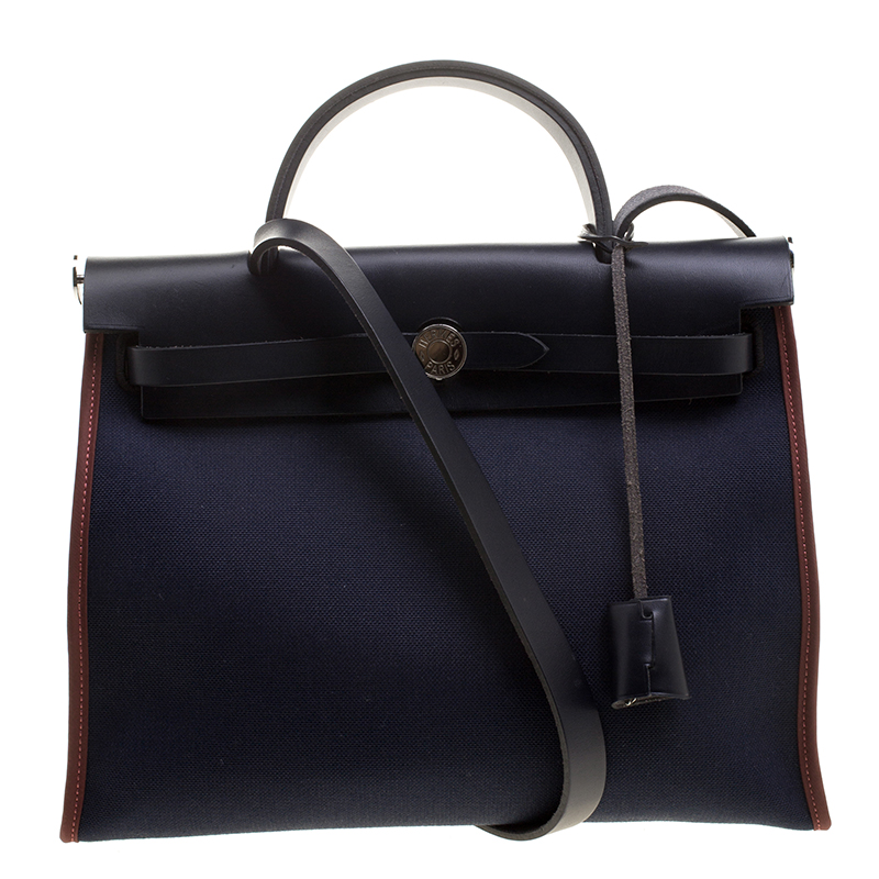 ... Hermes Black Navy Blue Leather and Canvas Herbag Zip 31 Bag. nextprev.  prevnext c6294c43b1b6d