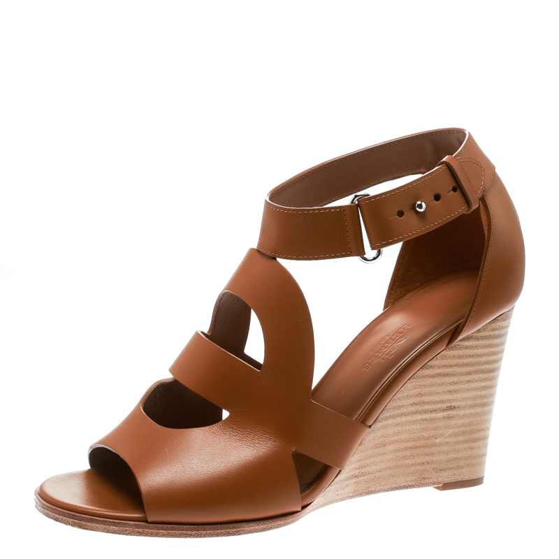 45250468ab7a ... Hermes Brown Leather Merryl Wedge Sandals Size 38. nextprev. prevnext