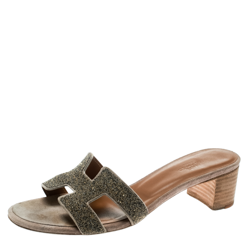 7808335e837a ... Hermes Gold Glitter Leather Oasis Slide Sandals Size 37. nextprev.  prevnext