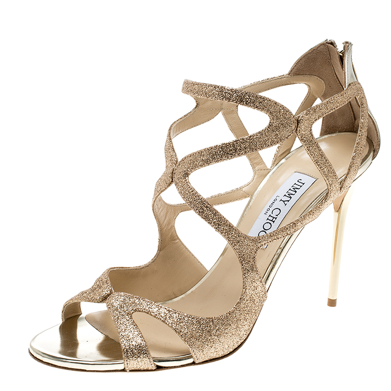 0f1ecb838cd3 ... Jimmy Choo Metallic Gold Glitter Leslie Strappy Sandals Size 41.  nextprev. prevnext. Share  verified authenticity · Hassle-free returnsfree  delivery