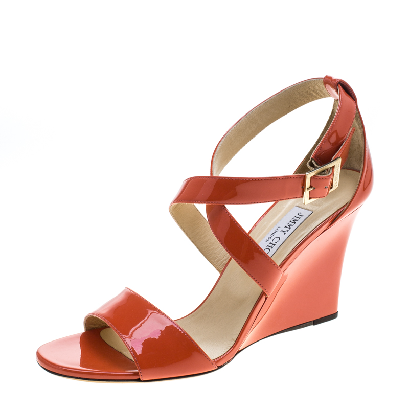 694c5569bf ... Jimmy Choo Orange Patent Leather Fearne Criss Cross Strap Wedge Sandals  Size 41. nextprev. prevnext