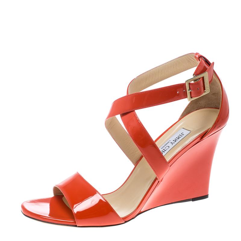 f8f5f9ce4e ... Jimmy Choo Coral Orange Patent Leather Fearne Criss Cross Strap Wedge  Sandals Size 42. nextprev. prevnext