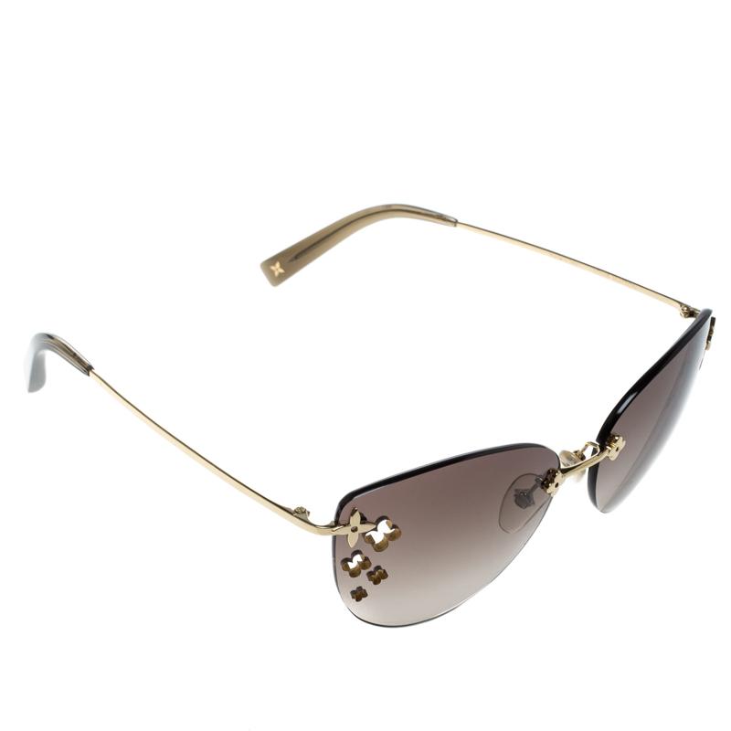 903aaca7dc ... Louis Vuitton Brown Gradient Z0051U Desmayo Rimless Cat Eye Women  Sunglasses. nextprev. prevnext