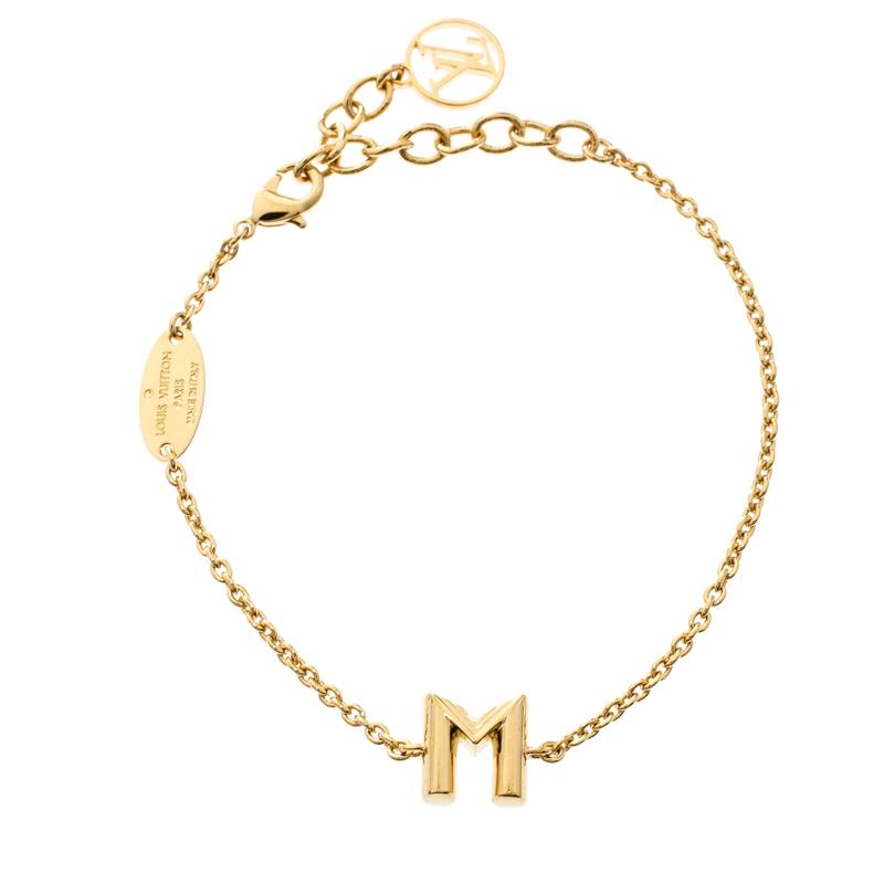 c85bc8fec558 ... Louis Vuitton LV   Me Letter M Gold Tone Bracelet. nextprev. prevnext
