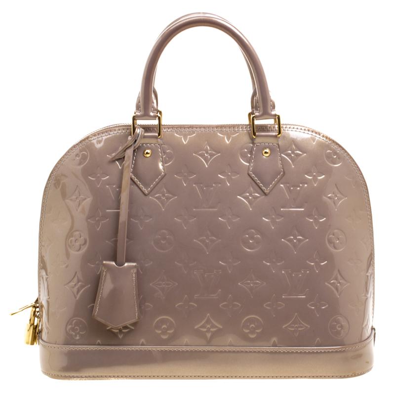 1c148c53feb ... Louis Vuitton Beige Poudre Monogram Vernis Alma PM Bag. nextprev.  prevnext