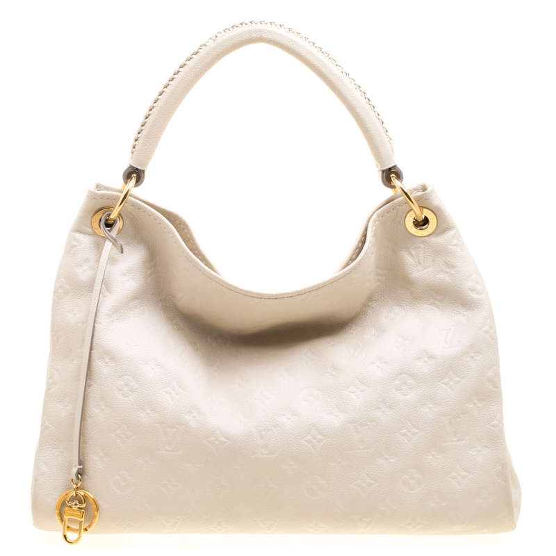 13b8f6997dcb ... Louis Vuitton Neige Monogram Empreinte Leather Artsy MM Bag. nextprev.  prevnext