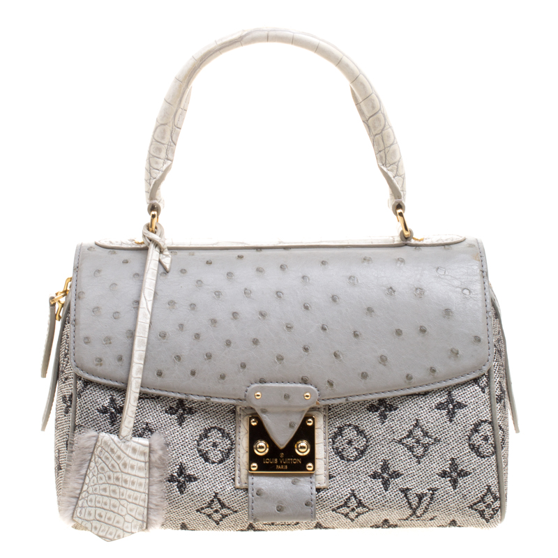 ... Louis Vuitton Grey Silver Monogram Ostrich Croc and Fabric Limited  Edition Comedie Carrousel Bag. nextprev. prevnext 859518de7274a