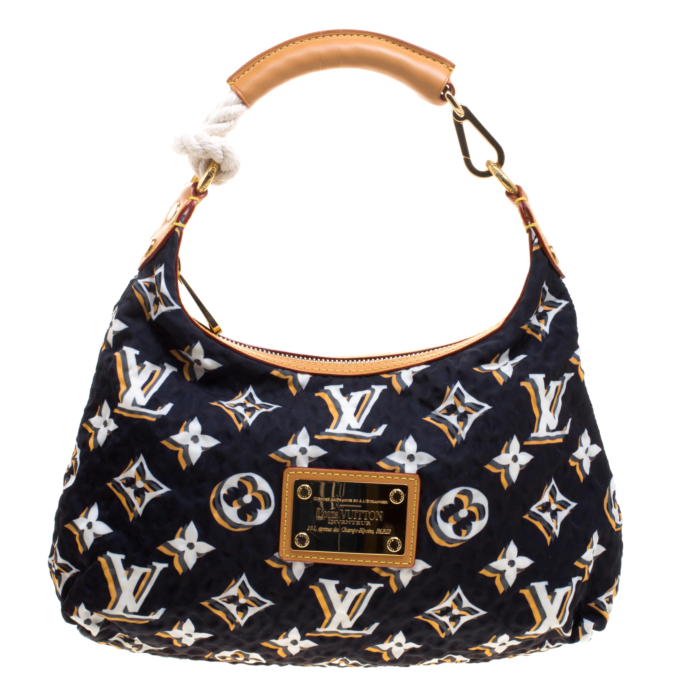 ... Navy Blue Monogram Fabric Limited Edition Bulles PM Bag. nextprev.  prevnext 58655e355219d