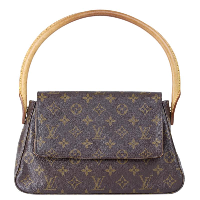 2b3c5a85899b ... Louis Vuitton Monogram Canvas Mini Looping Bag. nextprev. prevnext