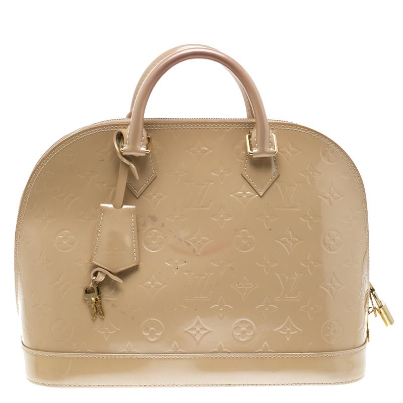 00565ce6e55f ... Louis Vuitton Beige Monogram Vernis Alma PM Bag. nextprev. prevnext