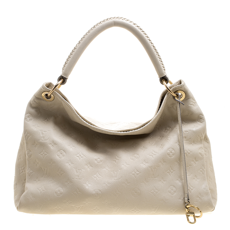 c6b4d54ba254 ... Louis Vuitton Cream Monogram Empreinte Leather Artsy MM Bag. nextprev.  prevnext