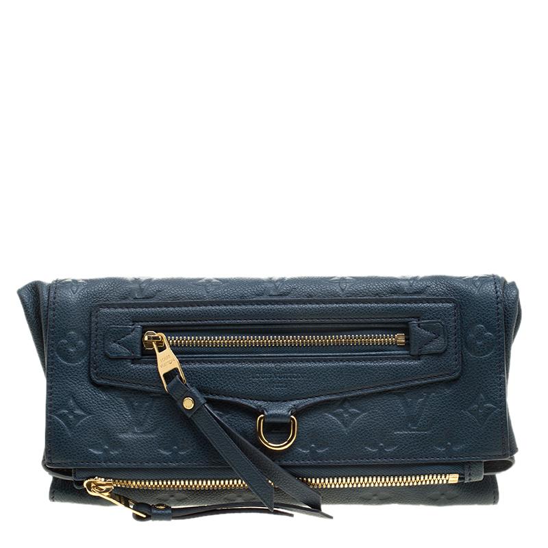 93c1014121bd ... Louis Vuitton Orage Monogram Empreinte Leather Petillante Clutch.  nextprev. prevnext