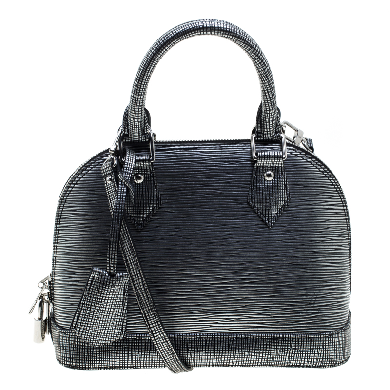 8cc567fd1d6d ... Louis Vuitton Metallic Silver Epi Leather Alma BB Bag. nextprev.  prevnext