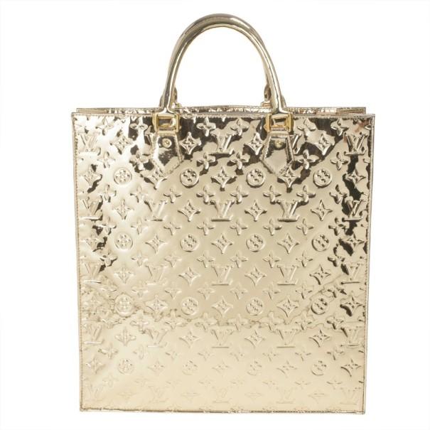 5302f0212625 ... Louis Vuitton Limited Edition Gold Monogram Miroir Sac Plat. nextprev.  prevnext