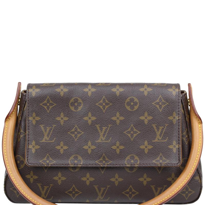 50303d98e9f0 ... Louis Vuitton Monogram Canvas Mini Looping Bag. nextprev. prevnext