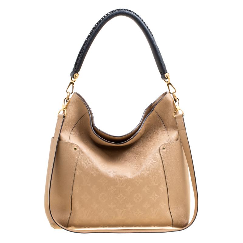 3067a65061f2 ... Louis Vuitton Dune Empriente Leather Bagatelle Bag. nextprev. prevnext