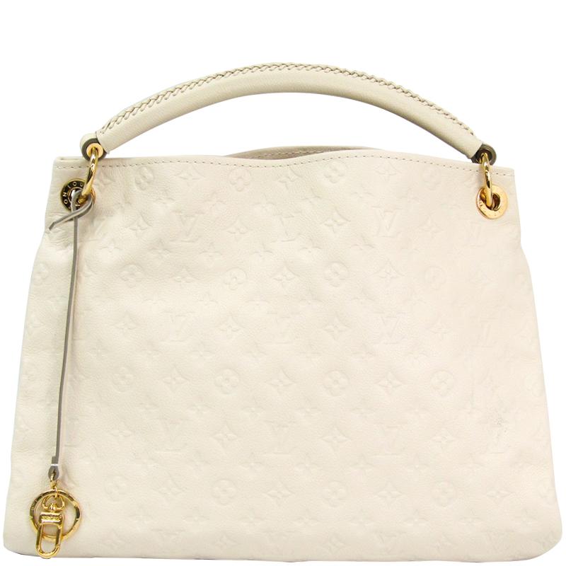 29f6226972c ... Louis Vuitton Neige Monogram Empreinte Leather Artsy MM Bag. nextprev.  prevnext