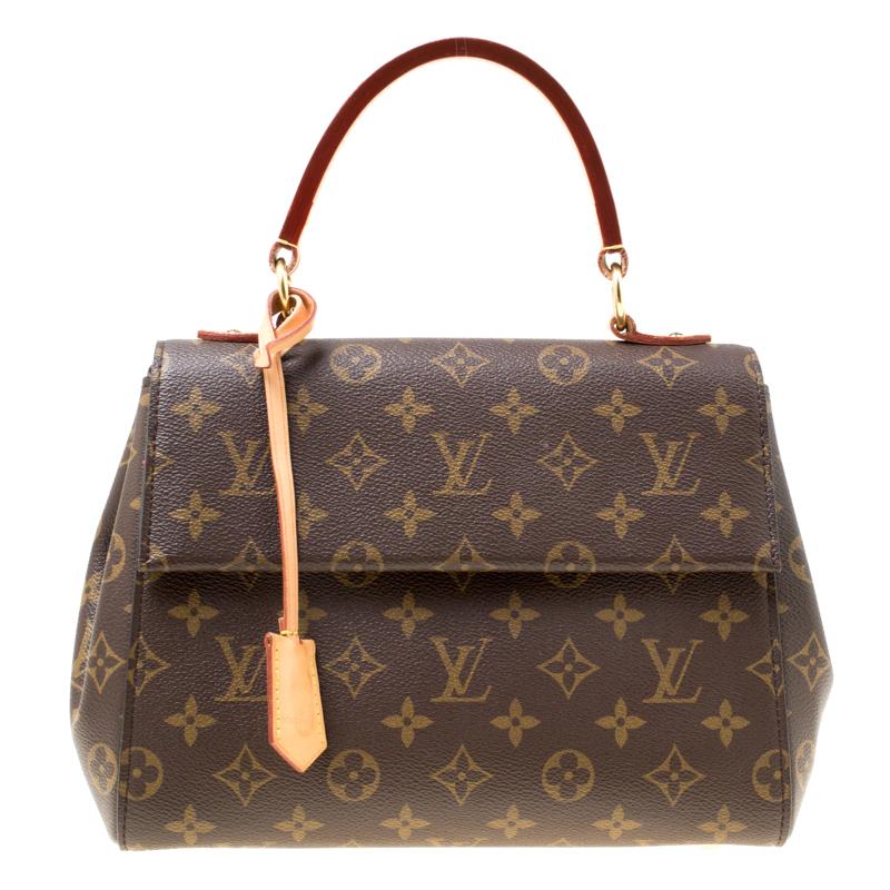 4786edd6ecd3 ... Louis Vuitton Monogram Canvas and Leather Cluny BB Top Handle Bag.  nextprev. prevnext
